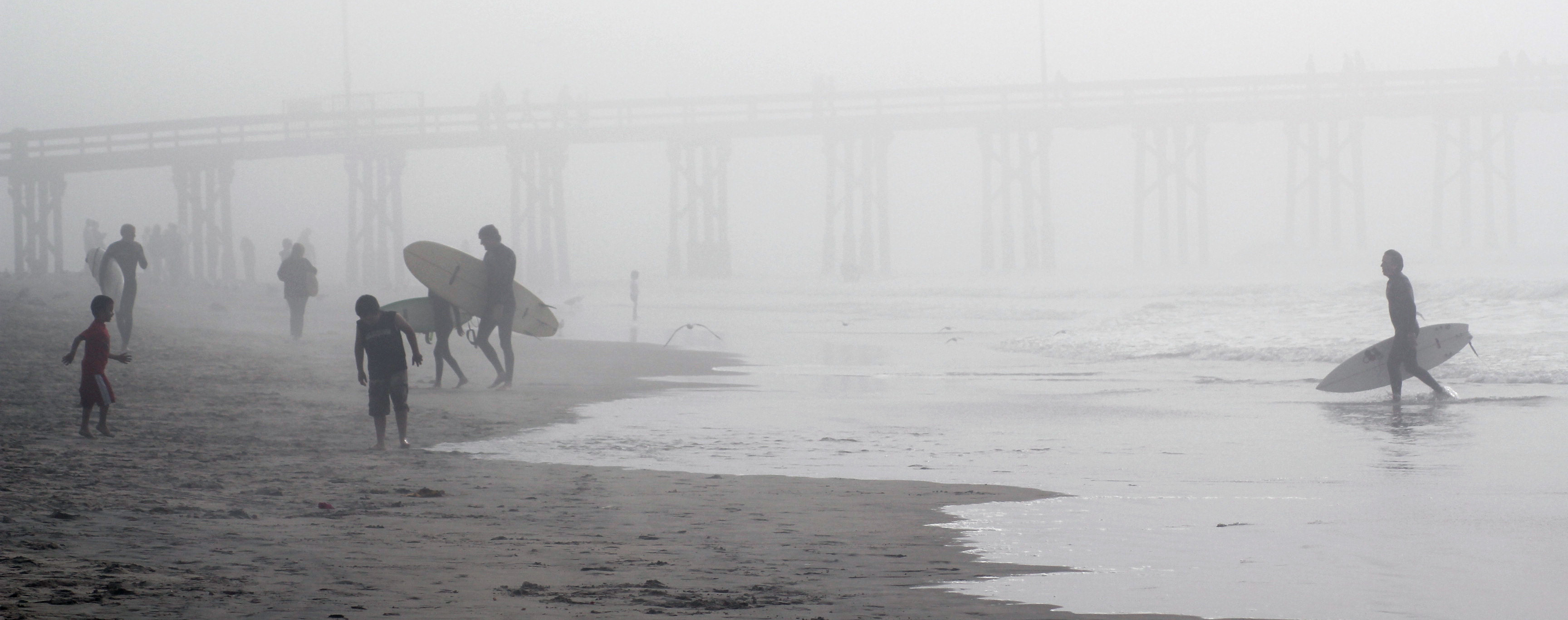 Surfers in the Mist